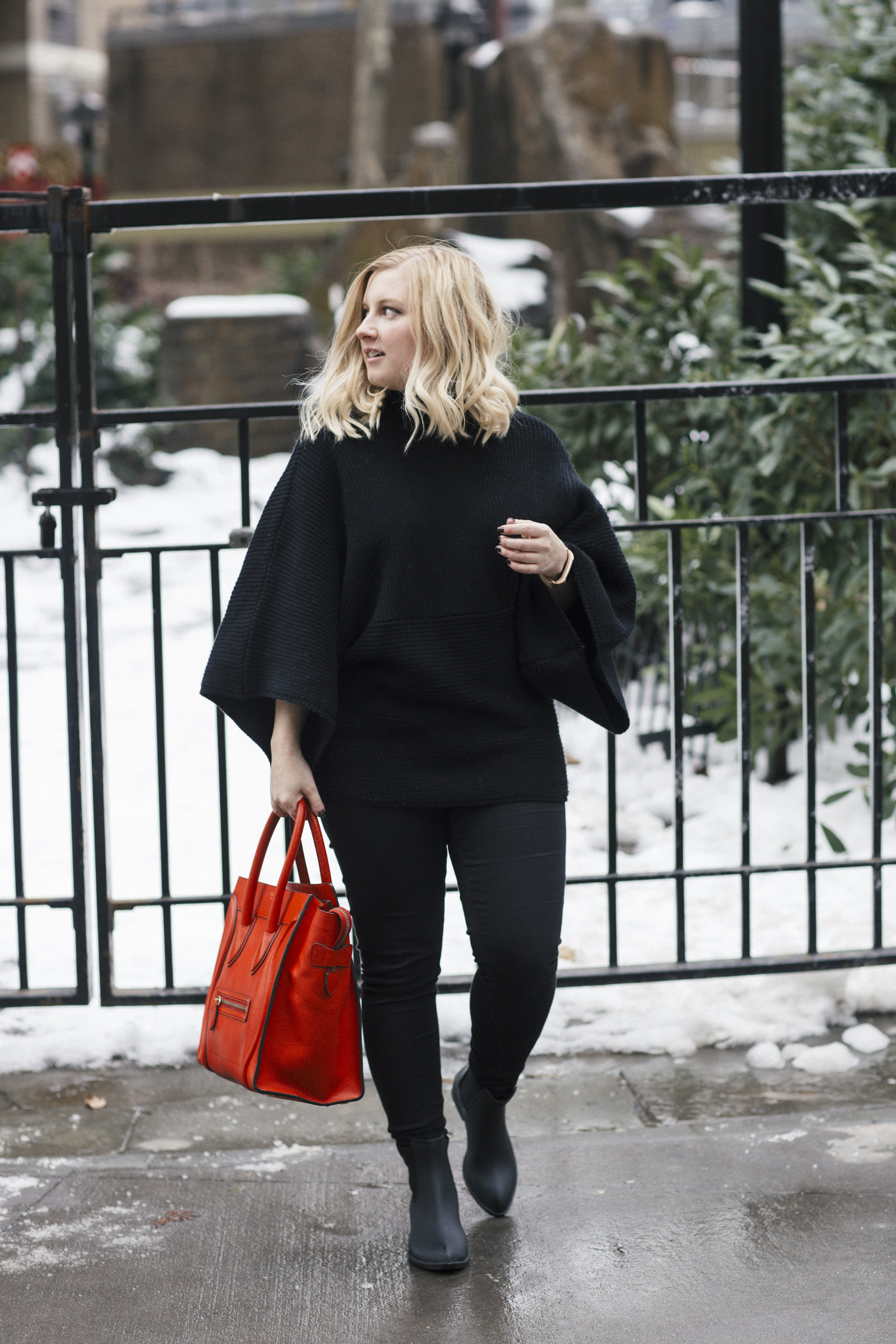Paired a red Celine with an all black outfit to create this NYFW ready look! Save money on designer items by shopping 5% off at Trendlee!